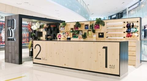 Sneha Divias creates 360 degrees wooden kiosk for department store in Dubai Mall