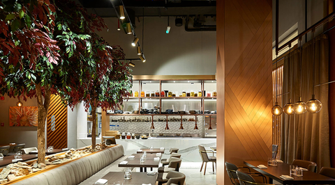 Swiss Bureau Interior Design's new F&B project transforms from daytime chic to lounge-inspired setting in the evening