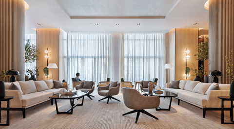 Lulie Fisher's design for new Vida hotel in Dubai features timber columns and pastel furniture