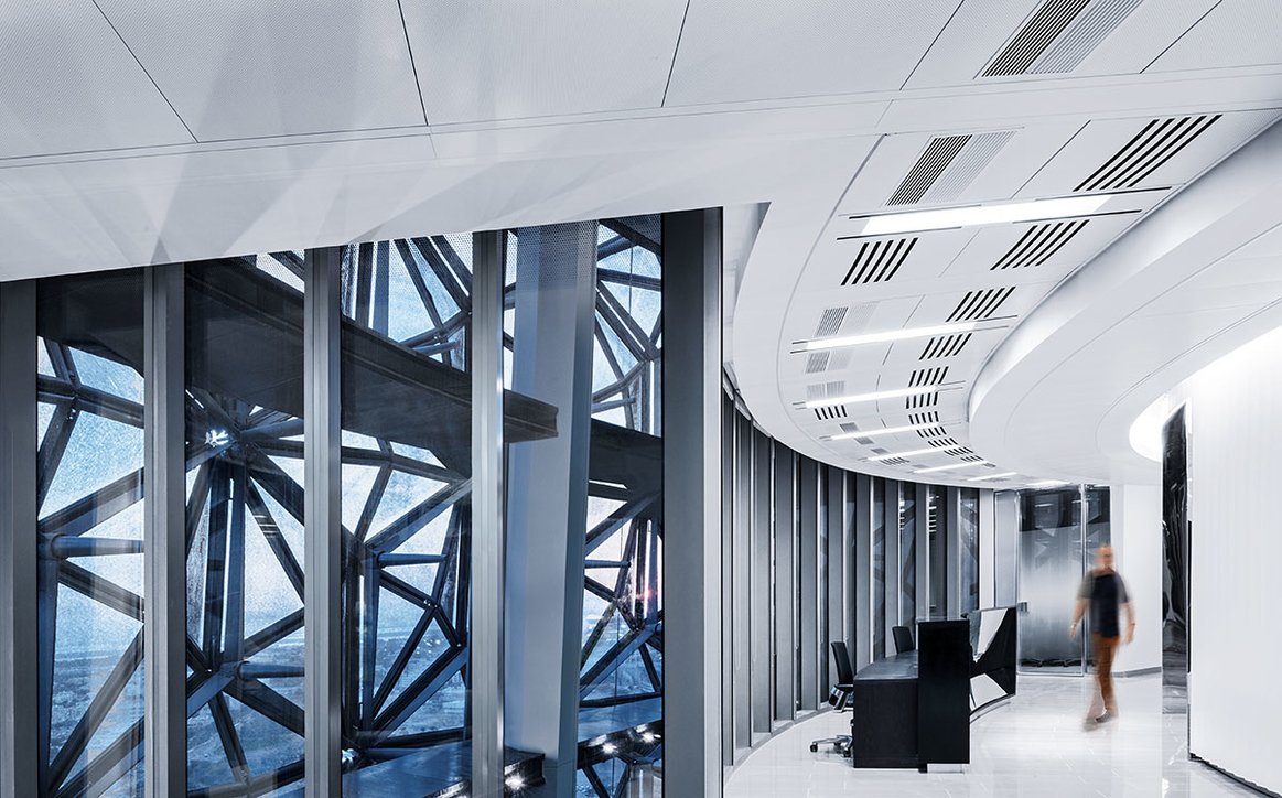 The vertical installation of the Slotlight II in the ceilings of the ADIC building accentuates a central design element of the architecture.