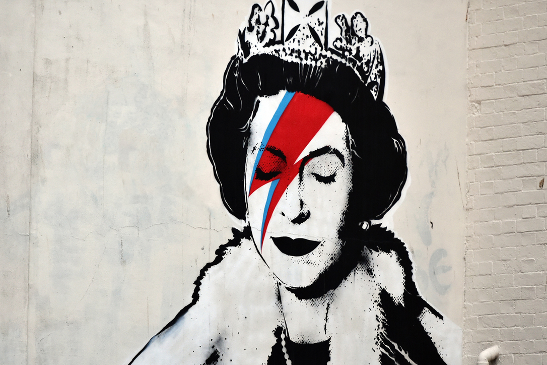 View of a Banksy piece depicting the Queen as David Bowie in his Ziggy Stardust persona