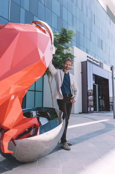 Neel Shuklar with his sculpture outside the Radisson Red in Dubai